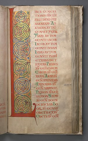 A book page with the letter L with colorful ornamentation.
