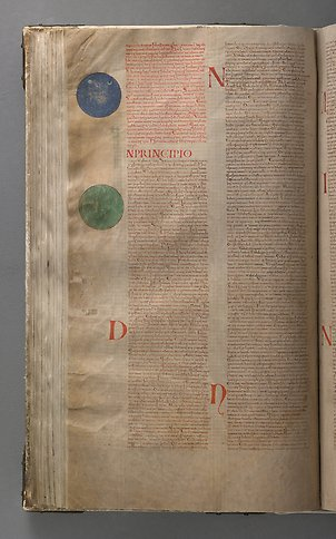 A book page with text and two circles in green and blue in the margin.