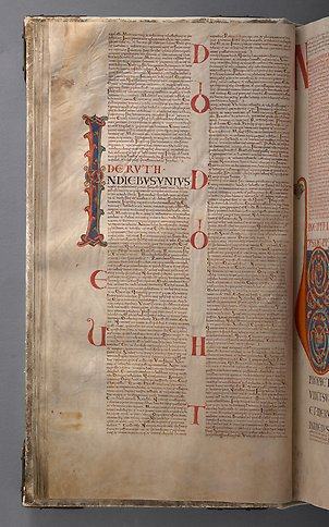 A book page with text and the initial I with colorful ornamentation.